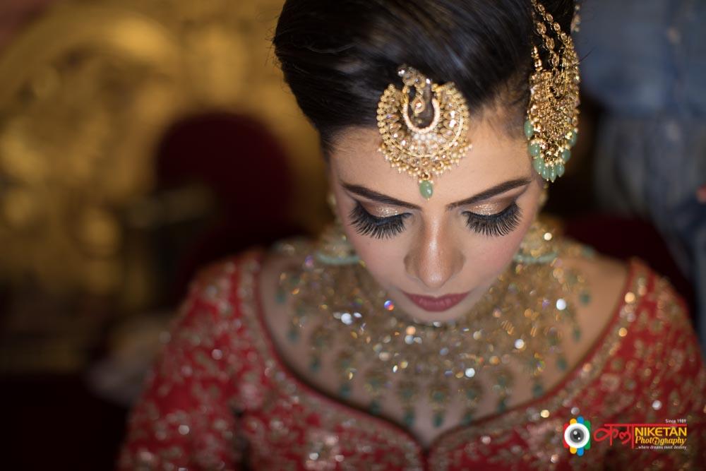 Bride in a Coral Pink Lehenga