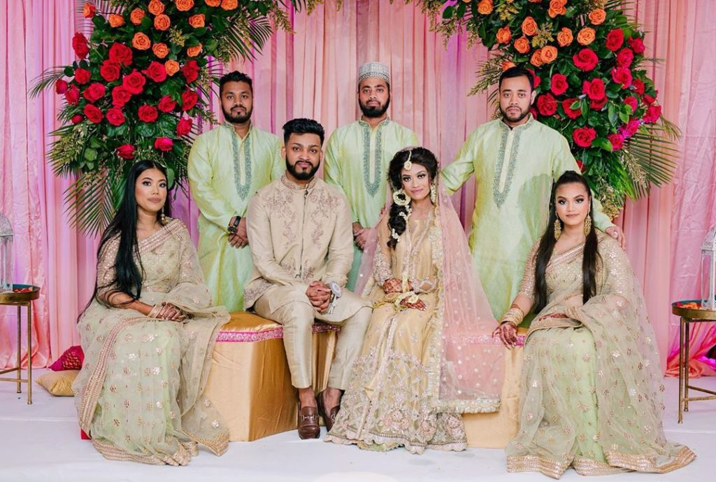 Coordinated mehendi outfits of bridesmaids & groomsmen