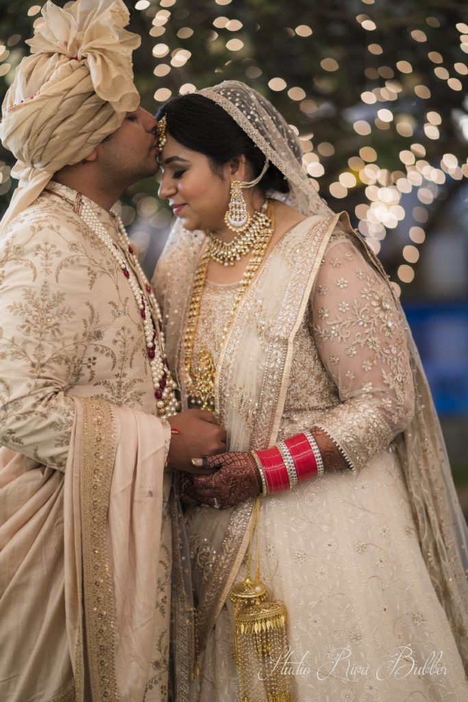 Indian bride & groom in color coordinated outfits