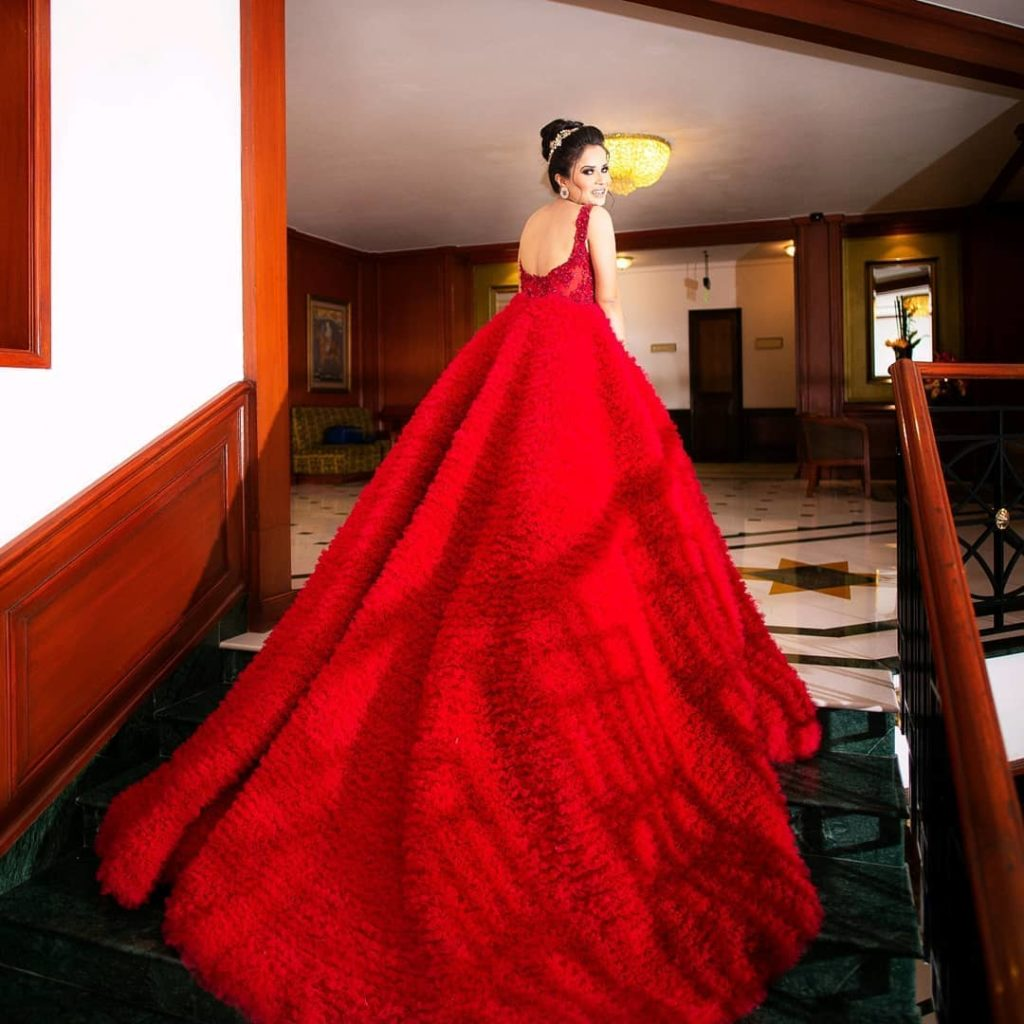 Bride in Red princess gown with train for engagement