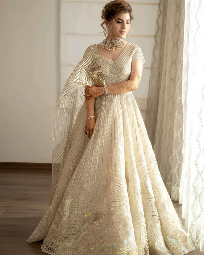 Bride in Ivory colored bridal gown for engagement
