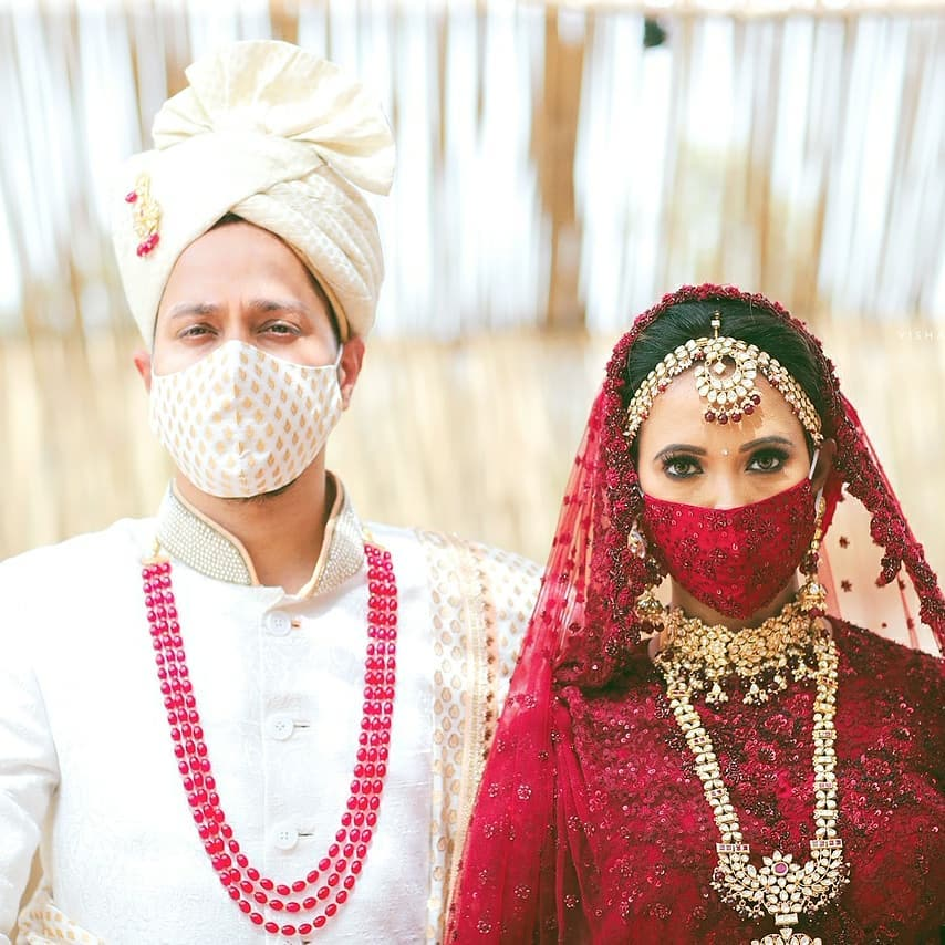 Indian bride & groom coordinates face masks with their wedding outfits