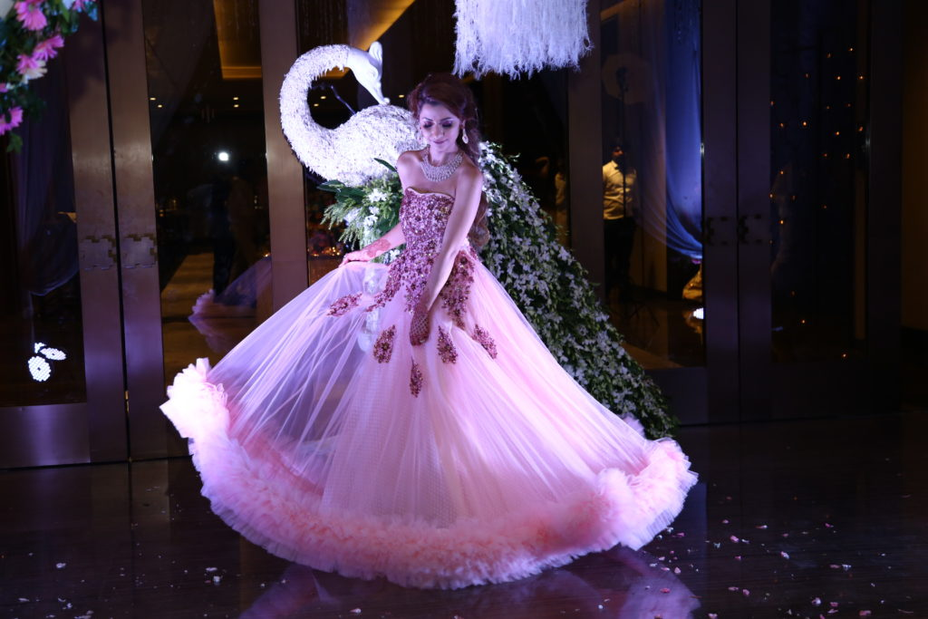 bride in pink princess gown
