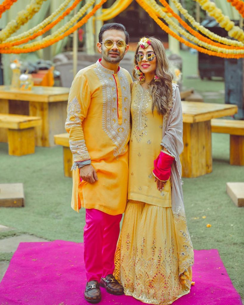 Indian Bride & groom in color coordinated outfits for Haldi