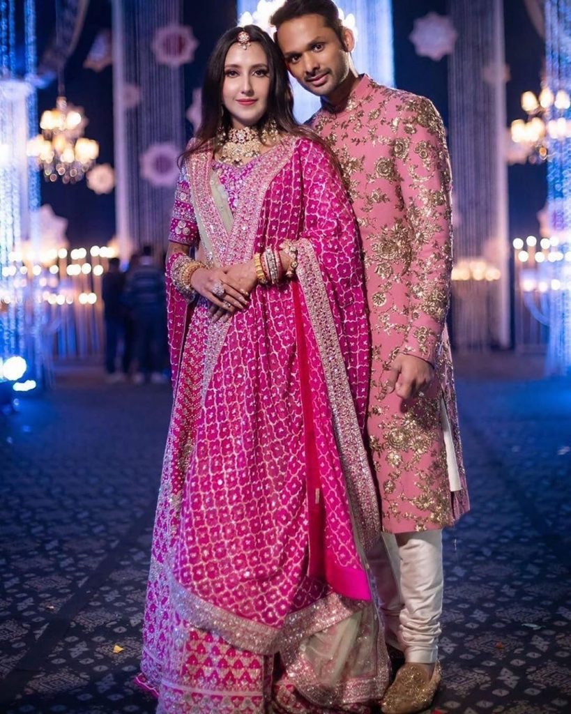 Groom in pink sherwani by Sabyasachi