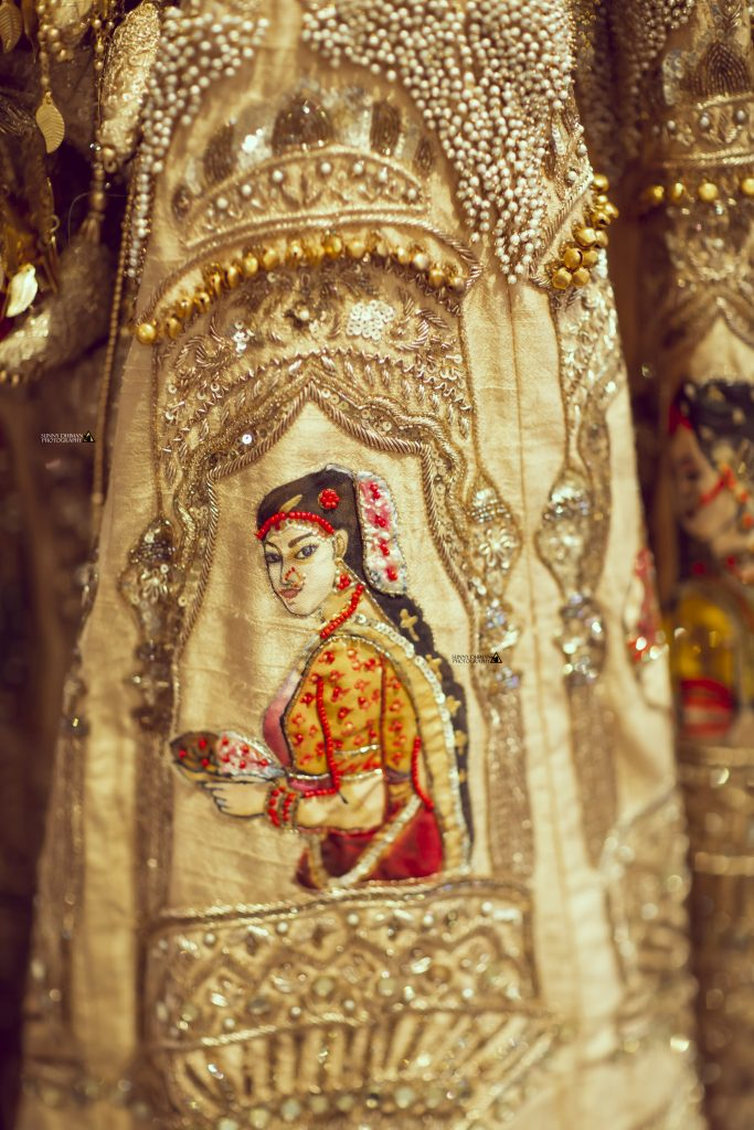 Bride in hand painted lehenga by her mother