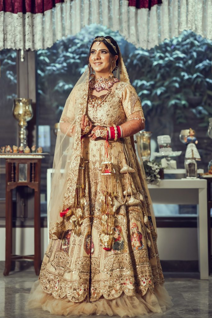 Indian bride in hand painted lehenga by mother