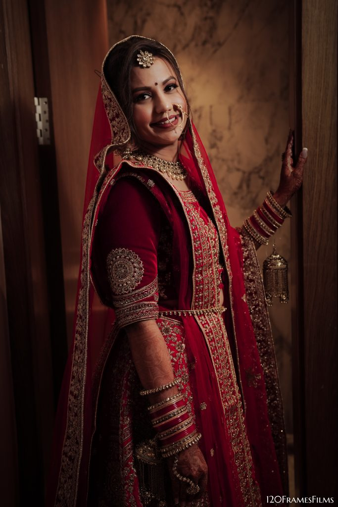 Bride in red lehenga for wedding