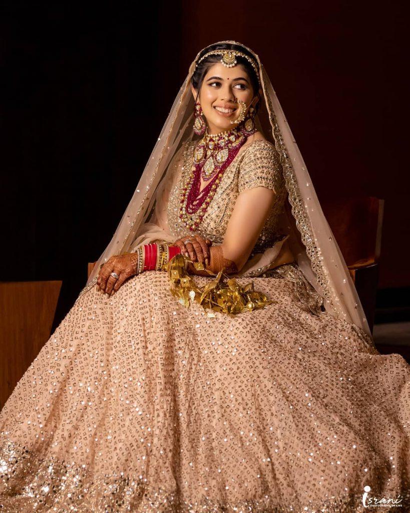 Megha Israni in peach lehenga for her wedding
