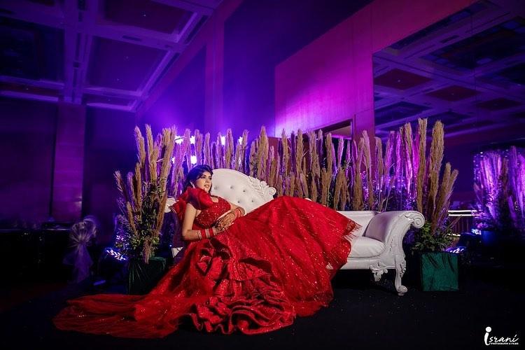 Israni Photography Founder Megha Israni in Red lehenga for Sangeet