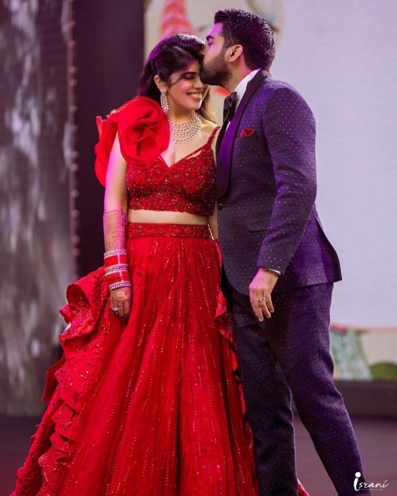 Megha Israni in red lehenga for sangeet