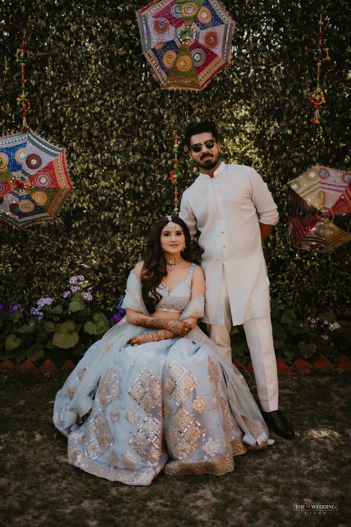 Delhi bride & groom in color coordinated outfits