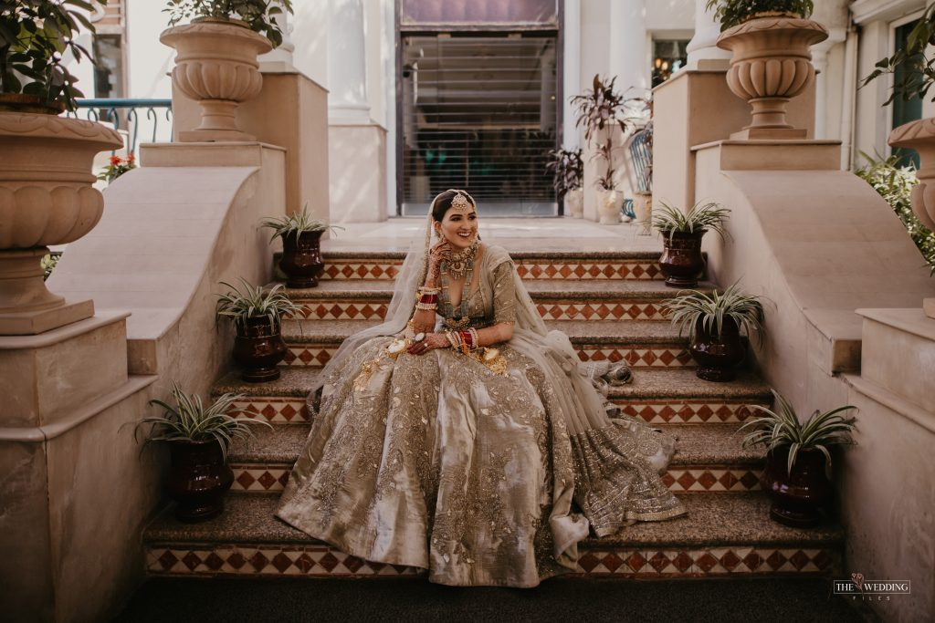 Indian bride in olive green lehenga for wedding