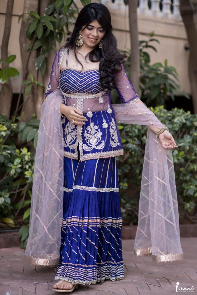 Lavish Wedding of Megha Israni - Bhajan Sandhya Outfit - Blue Sharara