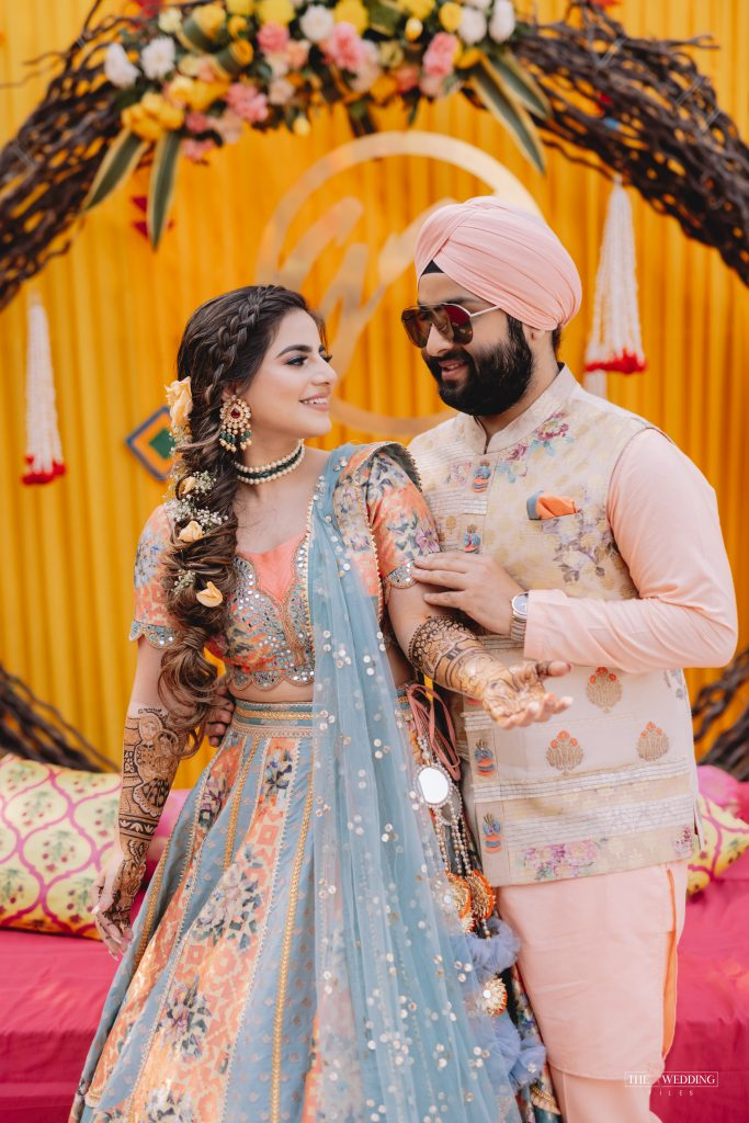 Sikh couple in color coordinated mehendi outfits
