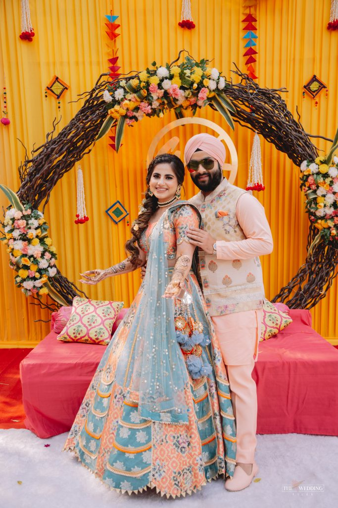 Sikh bride & groom in color-coordinated Mehendi Outfits