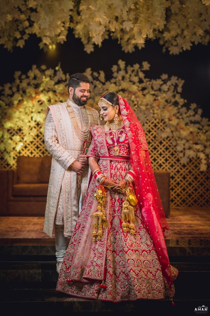 Indian bride & groom in most stunning wedding outfits