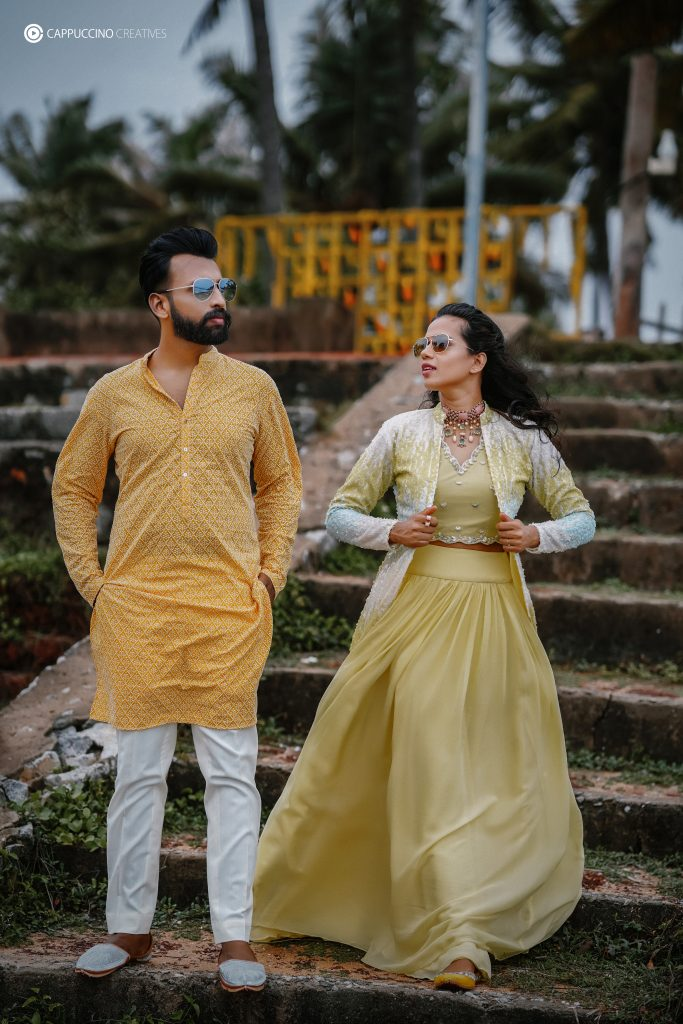 mysterious couple in color coordinated yellow outfits for Haldi