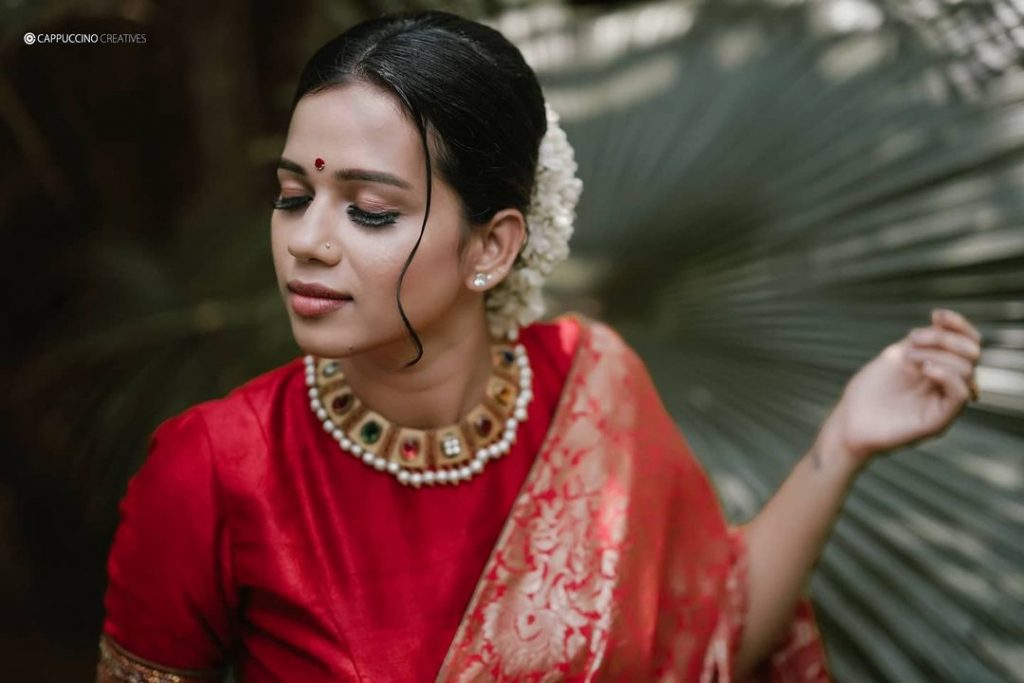 bride in traditional red saree for wedding