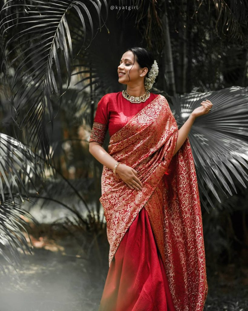 South Indian bride in traditional red saree for wedding